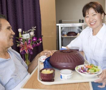 caregiver prepared food for elder man